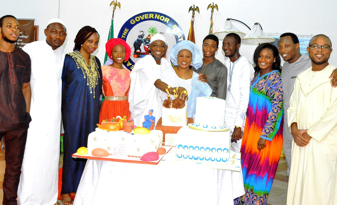 Governor State of Osun, Ogbeni Rauf Aregbesola;  his wife, Sherifat; Mr Kabiru Aregbesola (right); Qudir Aregbesola (5th right),Sakirat Aregbesola (4th left),Rauf Aregbesola (Junior)  (left);  Olateju Ishola (2nd left); Jumoke Oladeji (3rd left); Bode Oladeji (2nd right) and others, during the 57th Birthday celebration of Governor Aregbesola,  at Government house Osogbo
