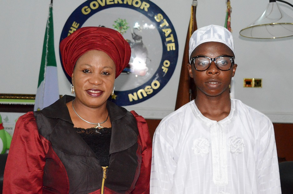Wife of the Governor State of Osun, Alhaja Sherifat Aregbesola (left) with the Overall Winner, State of Osun Public Schools Debate, Ayodele Habibllah (left), during his One-day with Ogbeni after Winning the Osun High School's Unity Debate Competition at Government House Osogbo, State of Osun on Monday 26-05-2014
