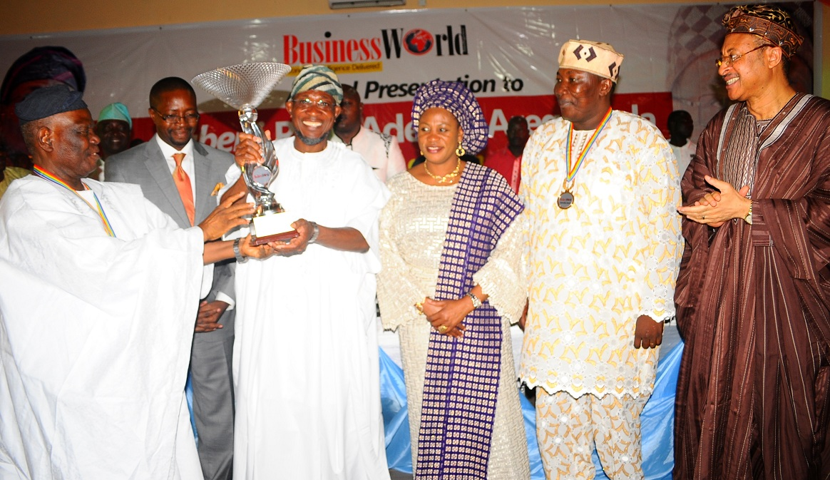 Governor State of Osun, Ogbeni Rauf Aregbesola (3rd left) receiving the BusinessWorld Newspaper Award as the Most Innovative Governor in his First Term Tenure from Chairman of the Occasion/Interim National Chairman, All Progressives Congress (APC), Chief Bisi Akande (left), during the Award Presentation at Zenababs Hotels and Resort, Ilesa, State of Osun on Saturday 03-05-2014. With them are, Wife of the Governor, Mrs Sherifat Aregbesola (3rd right); Chairman, BusinessWorld Newspaper, Mr Daisi Omidiji (2nd left); Speaker, State House of Assembly of Osun, Honourable Najeem Salam (2nd right) and Guest Speaker, Professor Pat Utomi (right).