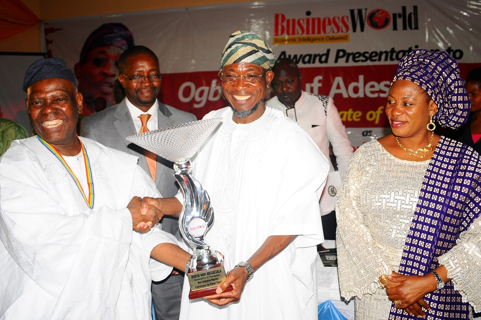 Governor State of Osun, Ogbeni Rauf Aregbesola (2nd right) receiving the BusinessWorld Newspaper Award as the Most Innovative Governor in his First Term Tenure from Chairman of the Occasion/Interim National Chairman, All Progressives Congress (APC), Chief Bisi Akande (left), during the Award Presentation at Zenababs Hotels and Resort, Ilesa, State of Osun on Saturday 03-05-2014. With them are, Wife of the Governor, Mrs Sherifat Aregbesola (right) and Chairman, BusinessWorld Newspaper, Mr Daisi Omidiji (2nd left).