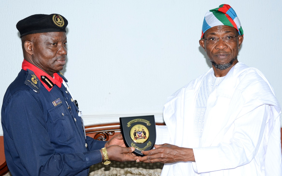 """Governor State of Osun, Ogbeni Rauf Aregbesola (right) and Assistant Commandant General, Nigeria Security and Civil Defense Corps (NSCDC) Zone """"F"""", Oladayo Amujare, during the Assistant Commandant's Visit to the Governor in Government House, Osogbo, State of Osun on Friday 16-05-2014"""