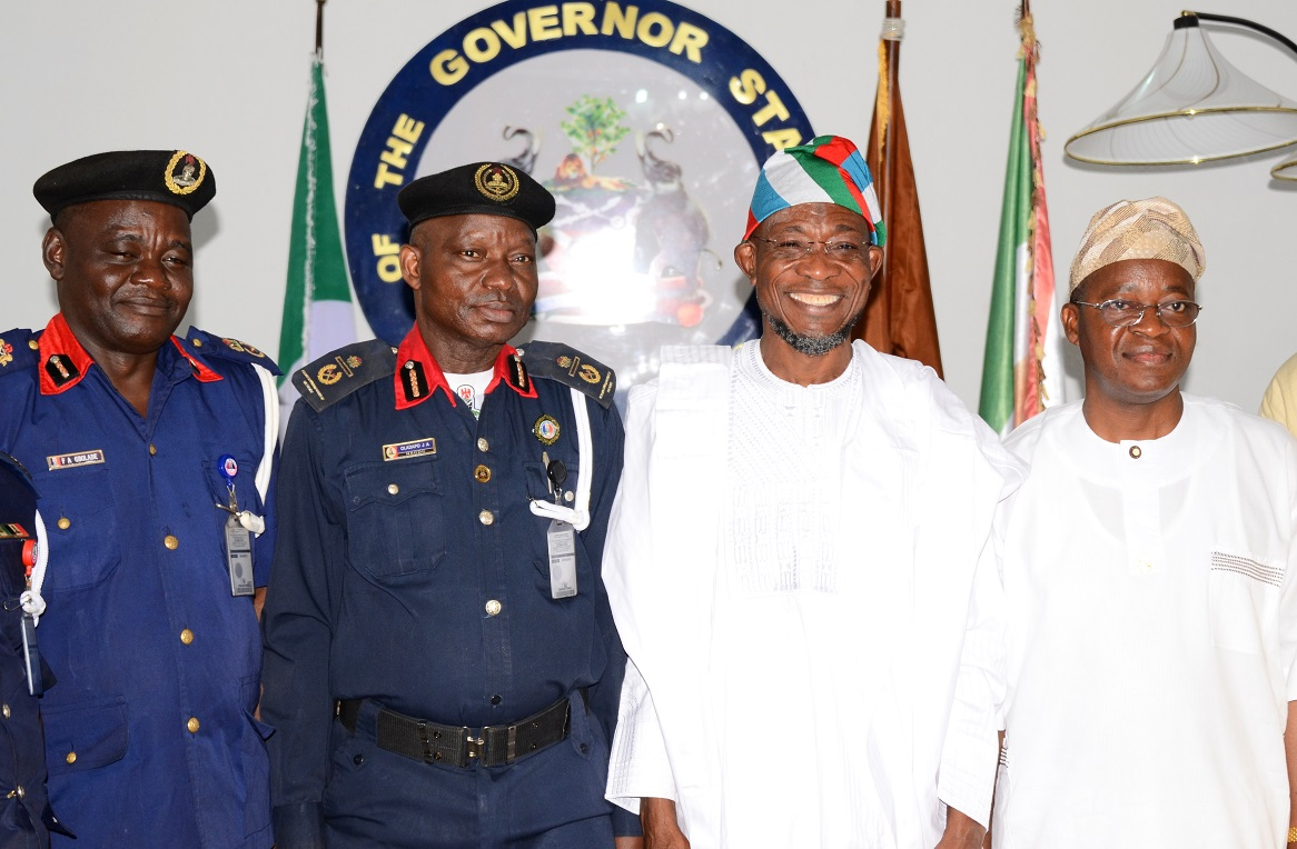 """Governor State of Osun, Ogbeni Rauf Aregbesola (2nd right); Assistant Commandant General, Nigeria Security and Civil Defense Corps (NSCDC) Zone """"F"""", Oladayo Amujare (2nd left); Chief of Staff to the Governor, Alhaji Gboyega Oyetola (right) and State of Osun NSCDC Commandant, Engineer Gbolade Felix (left), during the Assistant Commandant's Visit to the Governor in Government House, Osogbo, State of Osun on Friday 16-05-2014"""