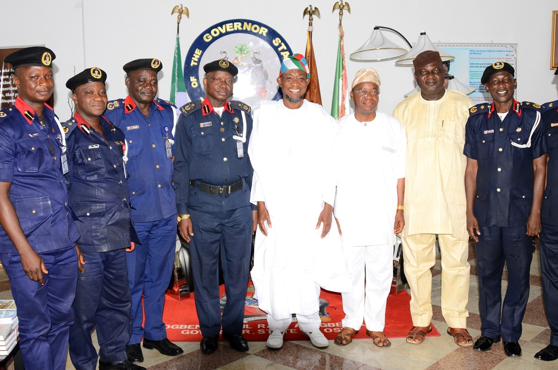 """Governor State of Osun, Ogbeni Rauf Aregbesola (4th right); Assistant Commandant General, Nigeria Security and Civil Defense Corps (NSCDC) Zone """"F"""", Oladayo Amujare (4th left); Chief of Staff to the Governor, Alhaji Gboyega Oyetola (3rd right); State of Osun NSCDC Commandant, Engineer Gbolade Felix (3rd left); Deputy Commandant, Operations NSCDC, Issa Akanbi (2nd left); Deputy Commandant NSCDC, Basiru Abdulazeez (right); Assistant Commandant, Head of Training, Adebiyi Ishola (left) and Interim Chairman, All Progressives Congress (APC), Osun Chapter, Elder Adelowo Adebiyi (2nd right), during the Assistant Commandant's Visit to the Governor in Government House, Osogbo, State of Osun on Friday 16-05-2014"""