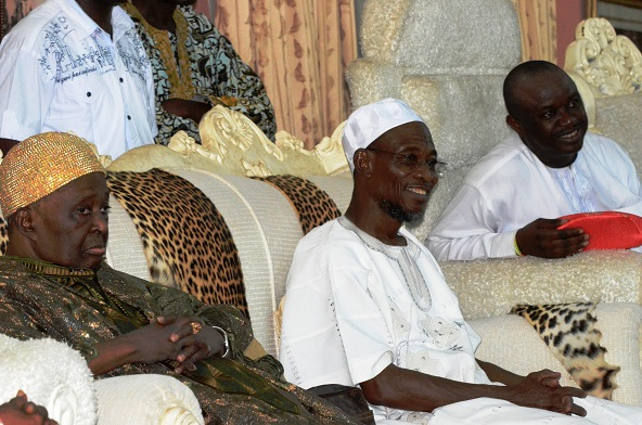The Ooni of Ife , Oba Okunade Sijuwade; Governor Rauf Aregbesola of the State of Osun and member, National Assembly, representing Osun East Senatorial District, Senator Babajide Omoworare, during the Official Flag-Off Campaign for Governor Aregbesola's  re-election into office, at Government Technical College, Ile-Ife, State of Osun on Tuesday 27-05-2014