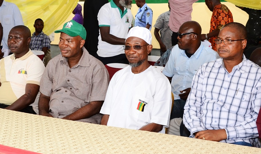 Special Adviser to the Governor on Commerce, Co-operative and Empowerment, Governor State of Osun, Ogbeni Rauf Aregbesola, Senior Special Assistant to State of Osun Governor on Civil& Public, Comrade Waheed Lawal and Chairman 2014 June 12 Organizing Committee, Comrade Shenge Rahman during the 2014 June 12 Programme at Freedom park, Osogbo State of Osun on Thursday 12-06-2014.