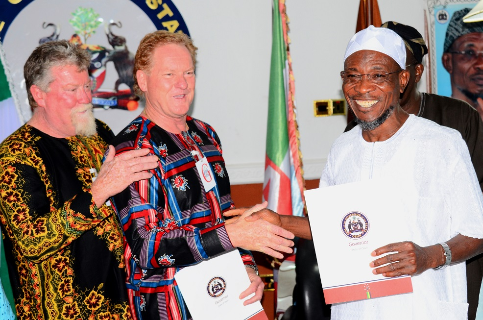 From right, Governor State of Osun, Ogbeni Rauf Aregbesola; Project Manager, Andalusian Mining Limited, Perth Western Australia, Colin Miller and Managing Director of the Company, Wayne Miller, during the Signing of Memorandum of Understanding (MoU) with the Firm for Gold Mining in Ilesa, at Government House, Osogbo, State of Osun on Saturday 28-06-2014
