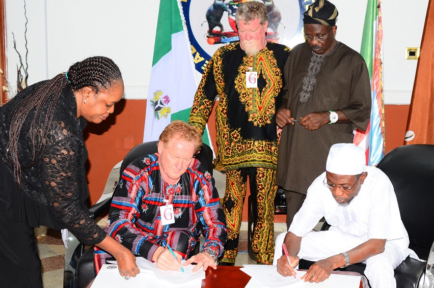 Governor State of Osun, Ogbeni Rauf Aregbesola (right) Signing the Memorandum of Understanding (MoU) with Project Manager, Andalusian Mining Limited, Perth Western Australia, Colin Miller (2nd left) for Gold Mining in Ilesa at Government House, Osogbo, State of Osun. With them are, Senior Special Assistant to the Governor on Mineral and Natural Resources, Prince Tunde Ajilore (2nd right); Solicitor General/Permanent Secretary, Ministry of Justice, Mrs Abiola Adewemimo (left) and Managing Director of the Firm, Wayne Miller on Saturday 28-06-2014