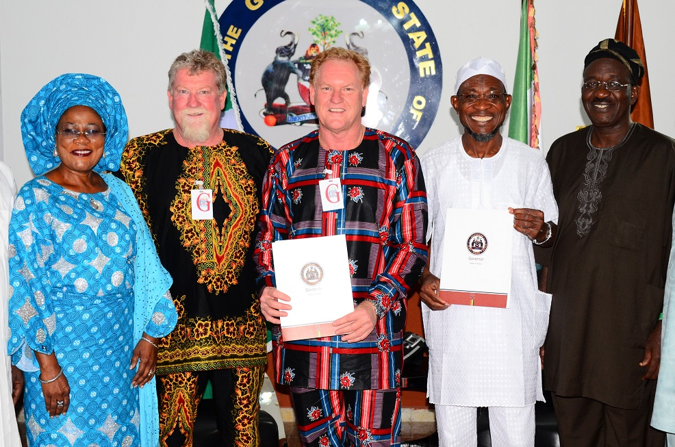 Governor State of Osun, Ogbeni Rauf Aregbesola (2nd right); his Deputy, Mrs Titi Laoye-Tomori (left); Project Manager, Andalusian Mining Limited, Perth Western Australia, Colin Miller (centre); Managing Director of the Firm, Wayne Miller (2nd left) and Senior Special Assistant to the Governor on Mineral and Natural Resources, Prince Tunde Ajilore (right), after Signing Memorandum of Understanding (MoU) with the Australian Firm for Gold Mining in Ilesa at Government House, Osogbo, State of Osun on Saturday 28-06-2014