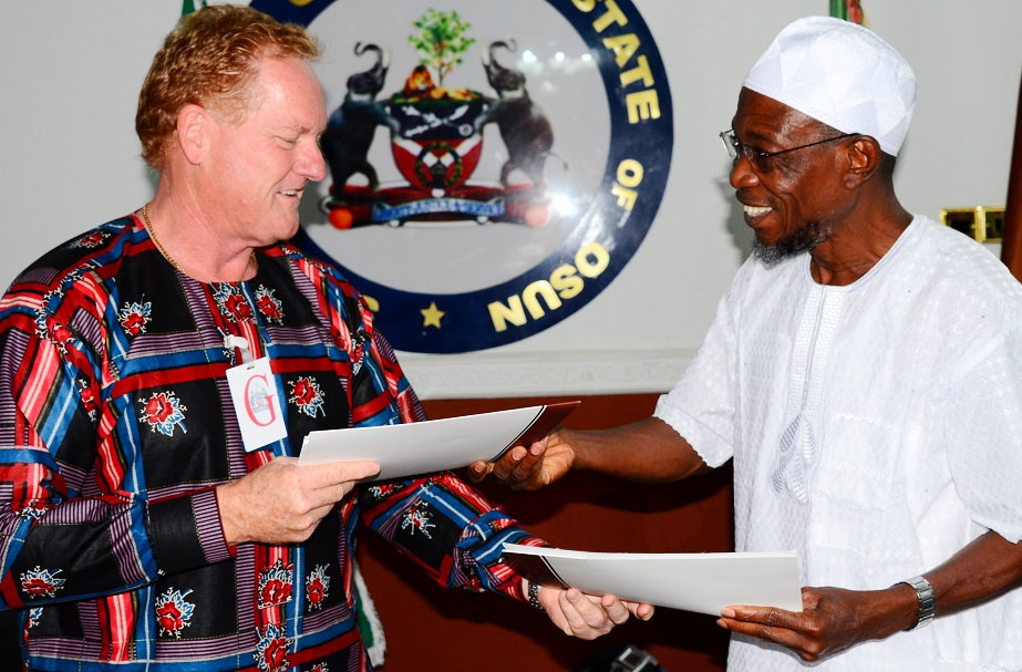 Governor State of Osun, Ogbeni Rauf Aregbesola (right) exchanging Signed Documents with Project Manager, Andalusian Mining Limited, Perth Western Australia, Colin Miller after Signing Memorandum of Understanding (MoU) with the Firm for Gold Mining in Ilesa at Government House, Osogbo, State of Osun on Saturday 28-06-2014