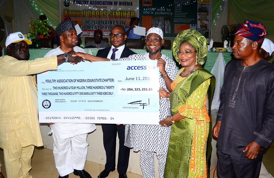 Governor State of Osun, Ogbeni Rauf Aregbesola (3rd right) Presenting a Cheque to Chairman, Poultry Association of Nigeria (PAN), Osun Chapter, Chief Oluyemi Olukiran (left); Deputy Governor, Mrs Titi Laoye-Tomori (2nd right); Chairman TUNS Group, Asiwaju Tunde Badmus (2nd left); Special Adviser to the Governor on Agriculture and Food Security, Mr Festus Agunbiade (right) and Access Bank Representatives, Mr Ayodeji Obelawo (3rd left), during an Annual Seminar for Osun Broiler Out-Growers' Production Scheme (OBOPS) and presentation of cheque to the association by the governor at Royal Spring Holiday Inn, Osogbo, State of Osun on Thursday 12-06-2014