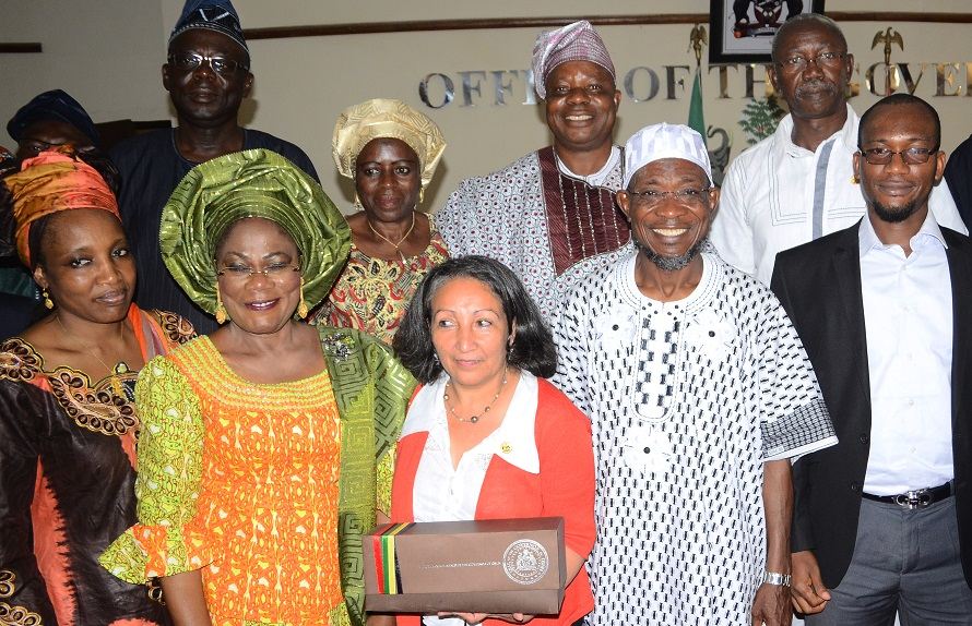 Governor State of Osun, Ogbeni Rauf Aregbesola (2nd right); his Deputy, Mrs Titi Laoye-Tomori (2nd left); Country Representative, United Nations International Children's Emergency Fund (UNICEF), Ms Jean Gough (centre); Social Policy Specialist, UNICEF Abuja, Maryam Abdu (left); Social Policy Specialist, UNICEF Lagos Field Office, Mohammad Okorie (right) and others, during UNICEF's Presentation and Courtesy Visit on the Governor in his Office, Osogbo, State of Osun on Wednesday 11-06-2014