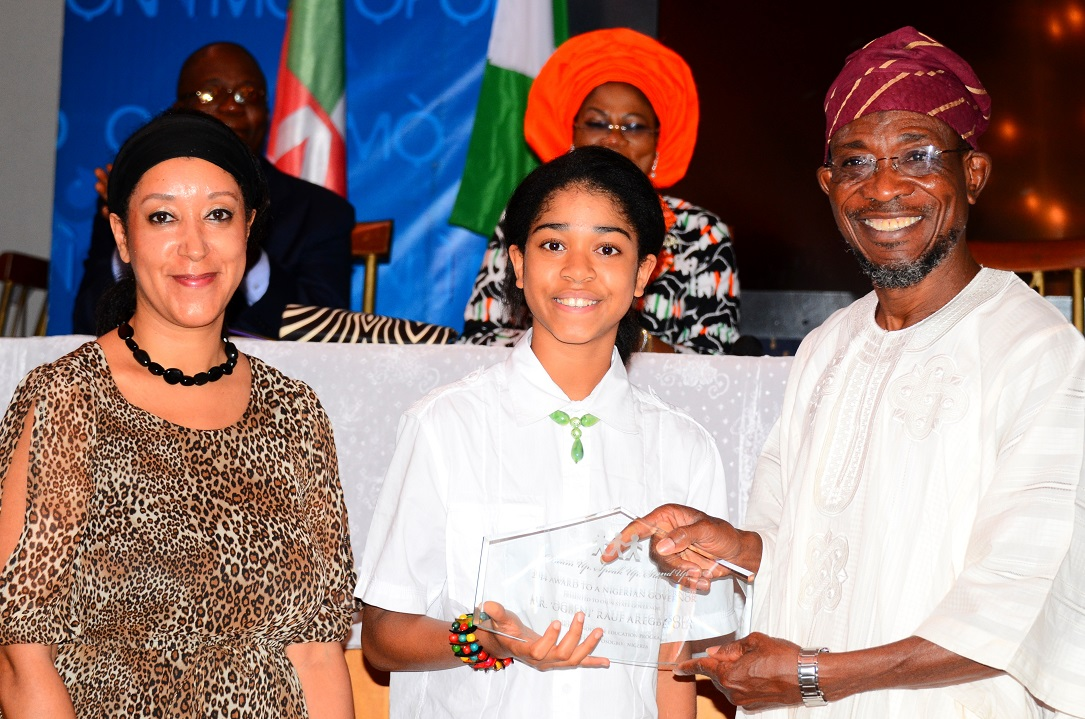 Governor State of Osun, Ogbeni Rauf Aregbesola (right) receiving an Award as the Most Innovative Governor Supporting Education in Nigeria from Initiator, Dream up; Speak up & Stand up Project/International Ambassador on Child Education Development,  Miss  Zuriel Oduwole (middle) and her Mother, Mrs Patricia Oduwole, at Government House Banquet Hall, Osogbo, State of Osun on Wednesday 02-07-2014