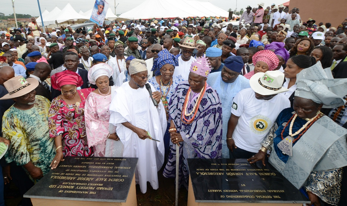 From left, Deputy Speaker, Osun House of Assembly, Honourable Akintunde Adegboye; Deputy Governor, Mrs Titi Loaye-Tomori; Wife of the Governor, Sherifat Aregbesola; Governor Rauf Aregbesola; Iyalode of Osogboland, Mrs Alake Kolade; Ataoja of Osogboland, Oba Jimoh Olanipekun; Executive Secretary, Osogbo Local Government, Mr Isiaka Faramade; Developer/Managing Director, Edward Property Konsult, Engineer Femi Oshoniyi; Iyaloja of Osogboland, Mrs Awawu Asindemade; Commissioner for Regional Integration and Special Duties, Honourable Basiru Ajibola (middle, with hat) and others, during the official commissioning of Ayegbaju International Modern Market in Osogbo, State of Osun on Monday 07-07-2014