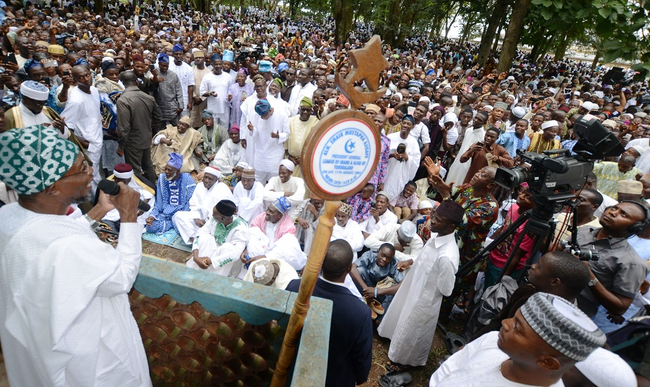 Governor State of Osun, Ogbeni Rauf Aregbesola (left) addressing the Muslim faithful, during 2014 Eid-El-Fitri prayer at Central Eid Praying Ground, Osogbo, State of Osun on Monday 28-07-2014