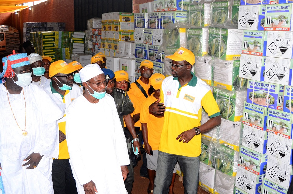 Governor State of Osun, Ogbeni Rauf Aregbesola (2nd left) inspecting the Farmers Input, during the Official Launching of the Framers Input and Credit Support Programme, at the Central Distribution Centre, Ede. With him are, Timi of Edeland, Oba Munirudeen Lawal (left); Coordinator, Osun Rural Enterprise and Agricultural Programme (OREAP), Dr Charles Akinola (behind governor); Executive Director, UniCapital Plc, Mr Ayo Fatokun (right) and others