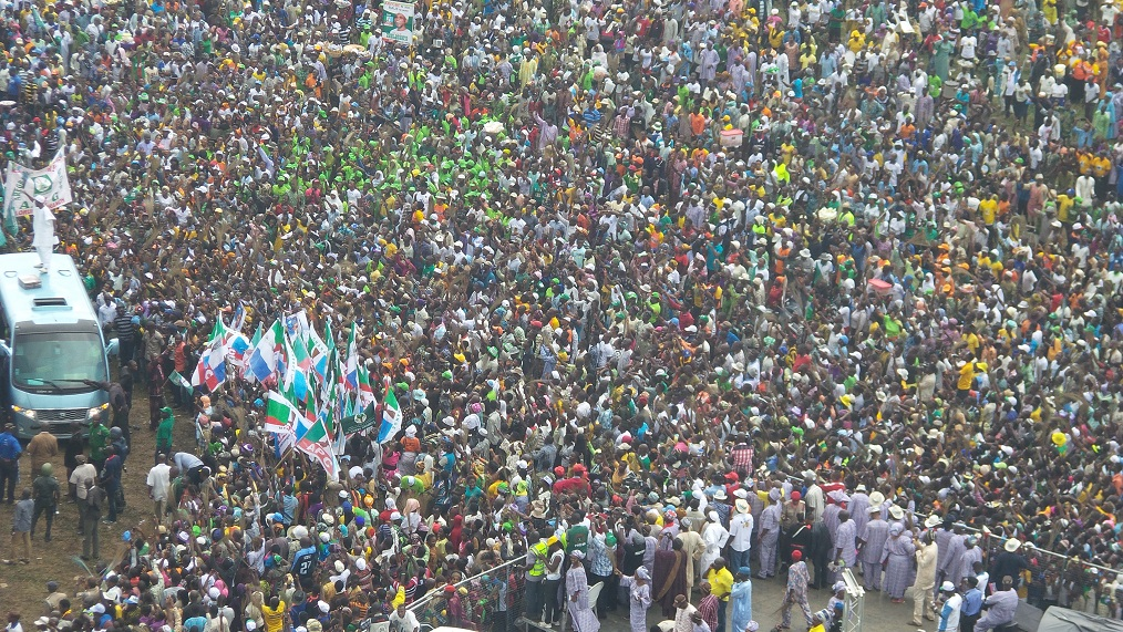 Governor of the State of Osun, Ogbeni Rauf Aregbesola (left on Top of Vehicle) acknowledging cheers from mammoth crowd during his Re-election campaign rally in Ijesa South Federal Constituency, Ilesa, State of Osun onTuesday 15-07-2014
