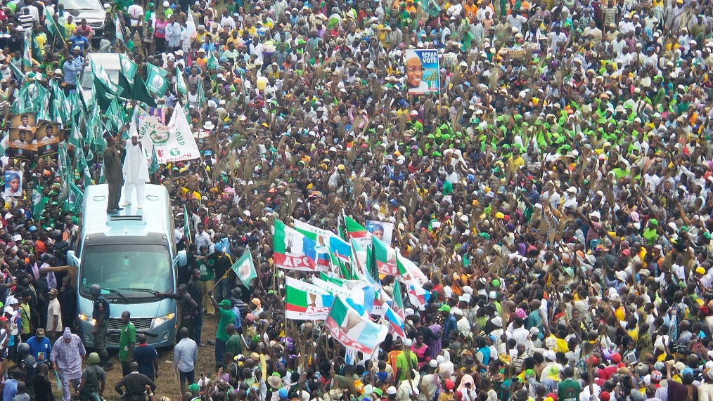 Governor of the State of Osun, Ogbeni Rauf Aregbesola and his Ogun State counterpart, Senator Ibikunle Amosun (left on Top of Vehicle) acknowledging cheers from mammoth crowd during his Re-election campaign rally in Ijesa South Federal Constituency, Ilesa, State of Osun onTuesday 15-07-2014