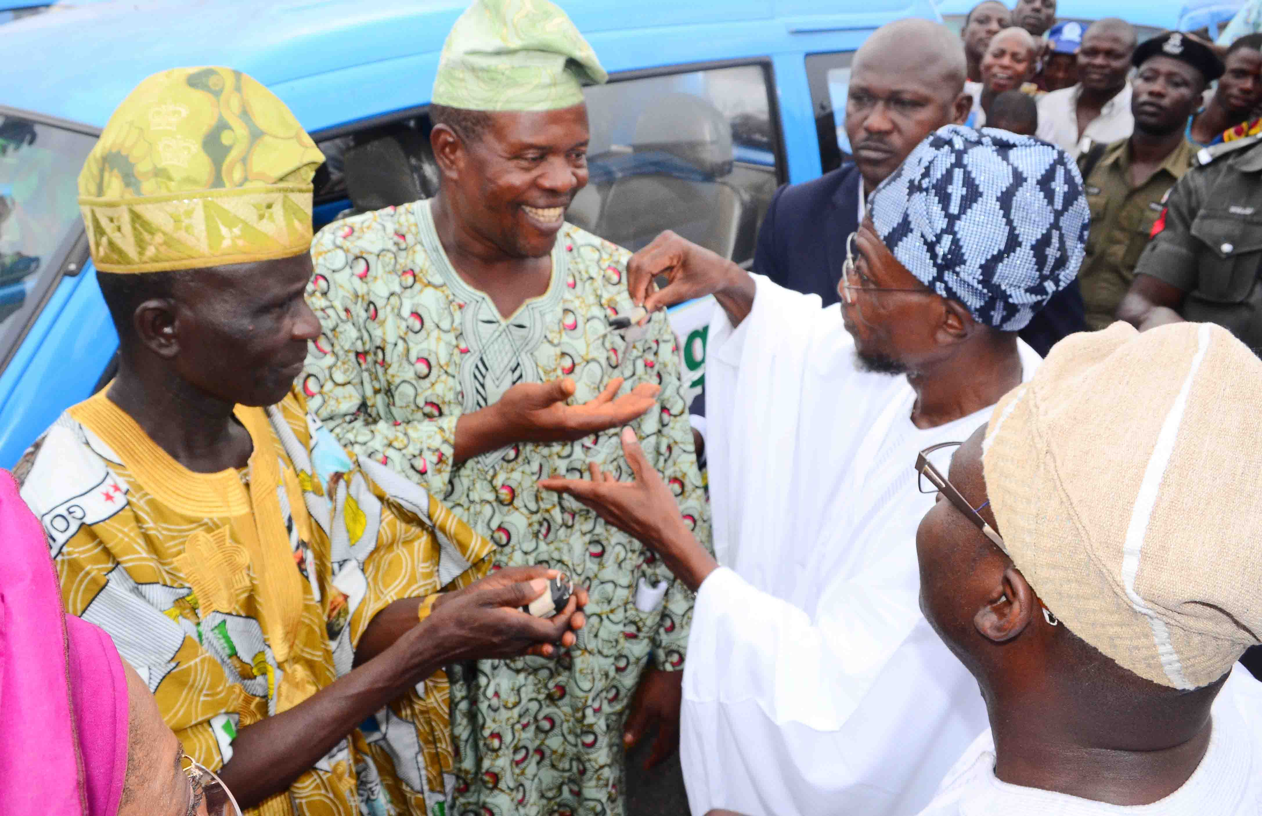 Governor State of Osun, Ogbeni Rauf Aregbesola (2nd right) handing-over key to one of the Mini-Buses to Zonal Chairman, Road Transport Employers Association of Nigeria (RTEAN) Osogbo/Olorunda/Irepodun/Orolu Local governments, Alhaji Rauf Agboola (2nd left), during the distribution and Launching of Micro Credit Agency at Nelson Mandela Freedom Park, Osogbo, State of Osun. With them are, Commissioner for Commerce, Industries, Cooperatives and Empowerment, Mr Ismaila Alagbada (right) and President, Cooperative Transporters, Alhaji Asimiyu Oladejo (left) on Wednesday 09-07-2014