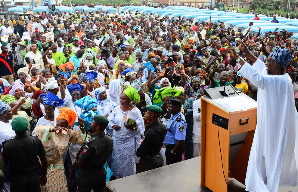 Governor State of Osun, Ogbeni Rauf Aregbesola (right) addressing the crowd, during the Launching of Micro Credit Agency and distribution of Mini-Buses to Cooperative Transporters and Road Transport Employers Association of Nigeria  (RTEAN) at Nelson Mandela Freedom Park, Osogbo, State of Osun on Wednesday 09-07-2014