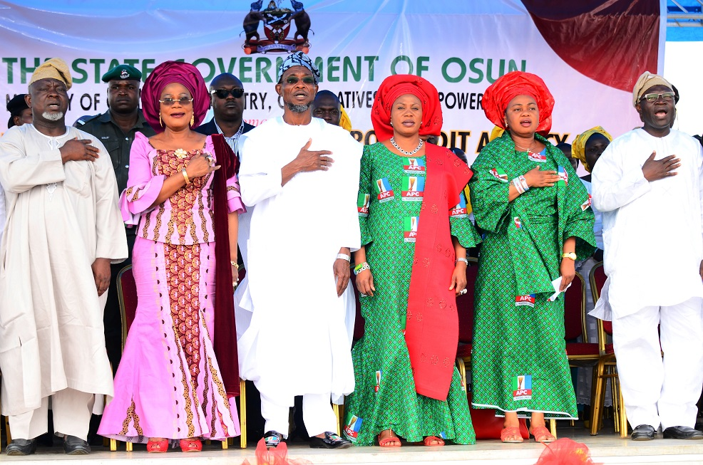 From left, Deputy Speaker, State of Osun House of Assembly, Honourable Akintunde Adegboye; Deputy Governor, Mrs Titi Laoye-Tomori; Governor Rauf Aregbesola; his Wife, Sherifat; Member, House of Representatives representing Irewole/Ayedaade/Isokan Federal Constituency, Honourable Ayo Omidiran and Commissioner for Commerce, Industries, Cooperatives and Empowerment, Mr Ismaila Alagbada, during the Launching of Micro Credit Agency and distribution of Mini-Buses to Cooperative Transporters and Road Transport Employers Association of Nigeria  (RTEAN) at Nelson Mandela Freedom Park, Osogbo, State of Osun on Wednesday 09-07-2014