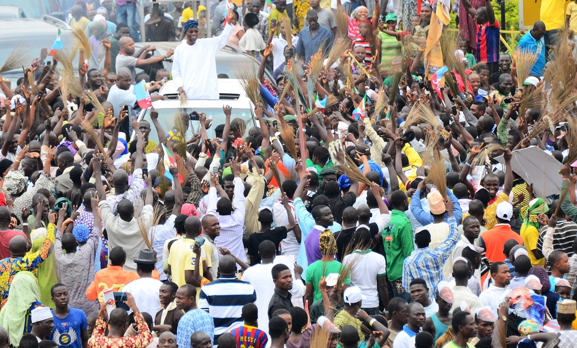 Governor State of osun, Ogbeni Rauf Aregbesola, acknowledging cheers from mammoth crowd who rejoice with him after been declare winner of Saturday's governorship poll in the state, at the Government House, Osogbo, Sate of Osun on Sunday 10-08-2014