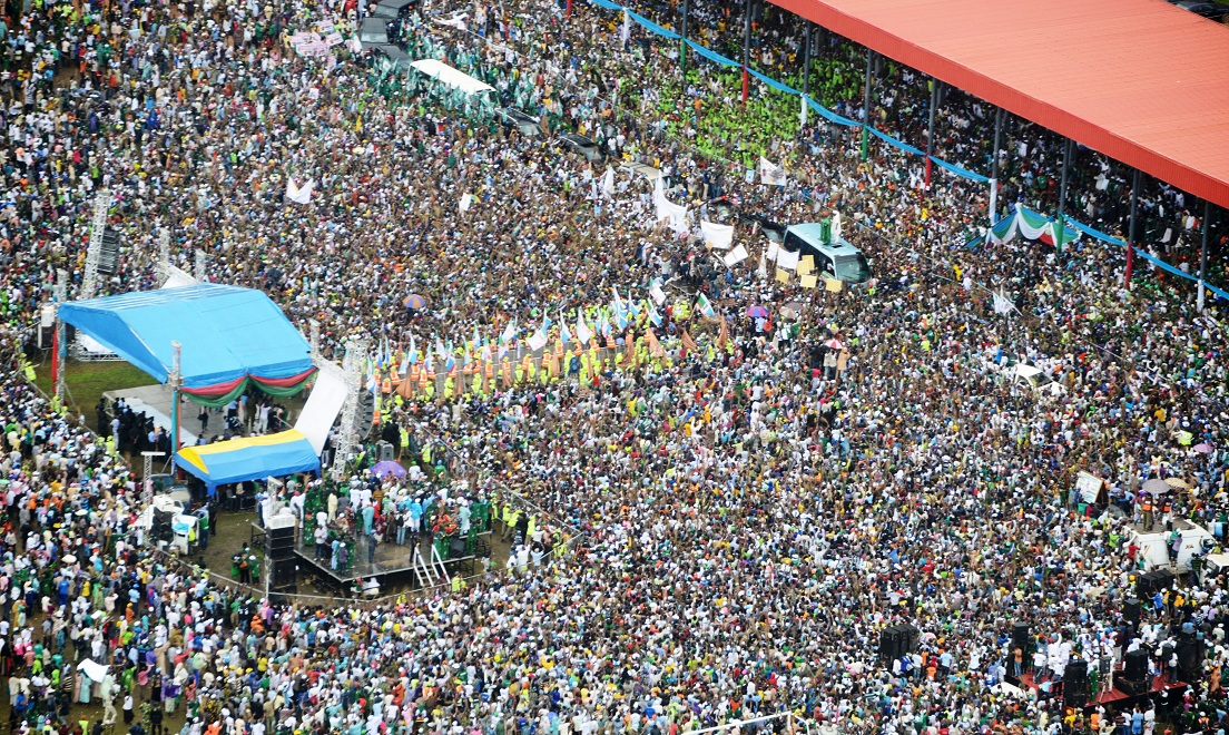 Governor State of Osun, ogbeni Rauf Aregbesola and his predecessor, Prince Olagunsoye Oyinlola (right on Top of the Bus), during the Mega Rally for the Re-election of Governor Aregbesola, at Osogbo City Stadium, Osogbo, State of Osun on Tuesday 05-08-2014