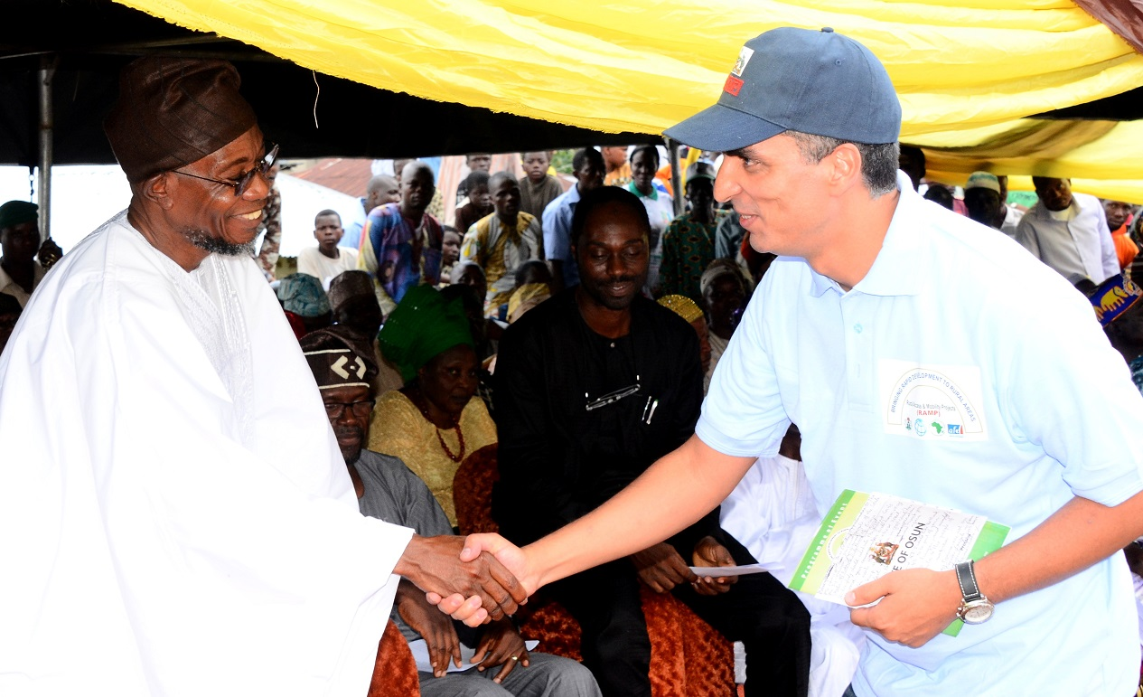 Governor State of Osun, Ogbeni Rauf Aregbesola (left) exchanging pleasantries with the Team Leader, World Bank/French Development Agency, Mr Mohammed Essakali, during the Flag Off for Construction of 225 KM Rural roads and Official Launch of Osun Rural Access and Mobility Project (RAMP) Phase II at Ira Open Square, Oriade Local Government Area, State of Osun at the Weekend