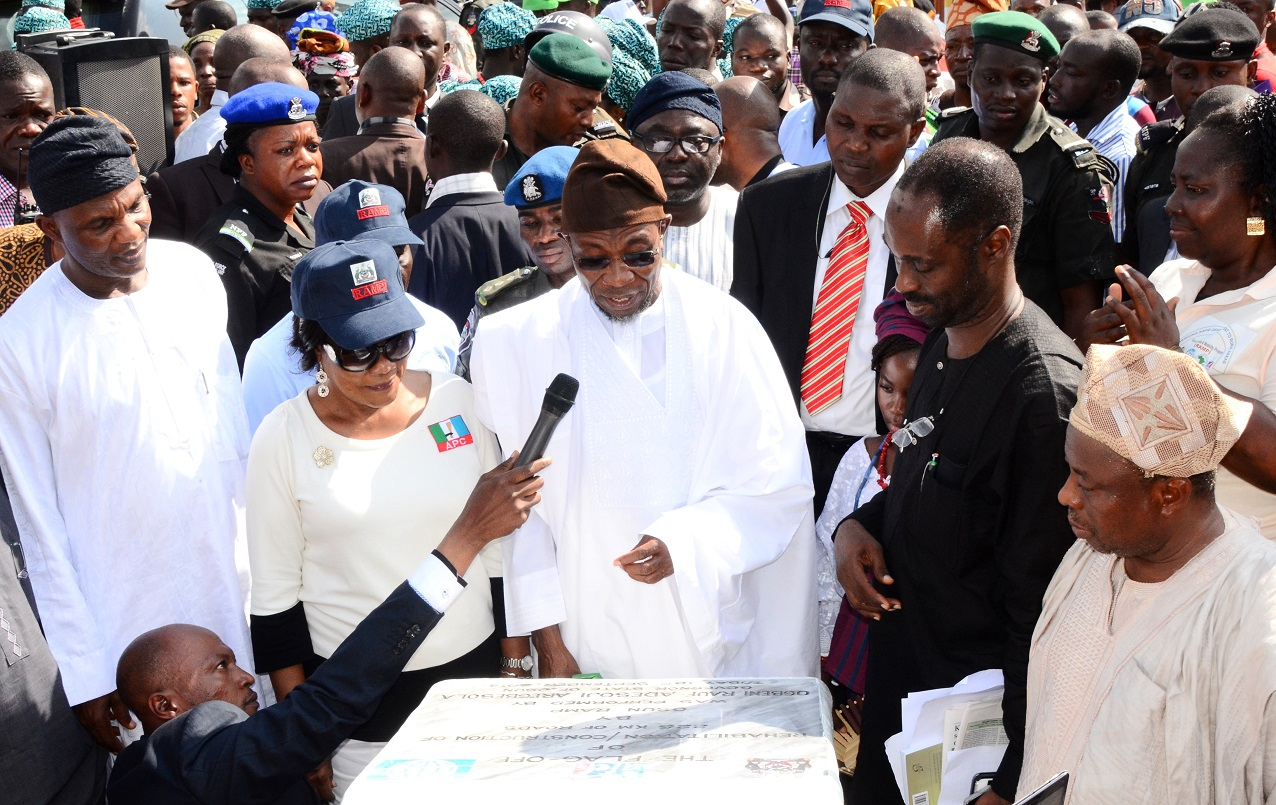 Governor State of Osun, Ogbeni Rauf Aregbesola (3rd left) flagging off the Construction of 225 KM Rural roads and Official Launch of Osun Rural Access and Mobility Project (RAMP) Phase II at Ira Open Square, Oriade Local Government Area of Osun. With him are, his Deputy, Mrs Titi Laoye-Tomori (2nd left); Special Adviser to the Governor on Water Resources, Rural Development and Community Affairs, Mr Kunle Ige (2nd right); Secretary to the State Government of Osun, Alhaji Moshood. Adeoti (left); Member, House of Assembly, Honourable Olatunji Ibraheem (right) and others, at the Weekend