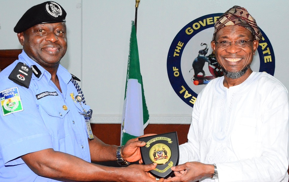 Governor State of Osun, Ogbeni Rauf Aregbesola presenting State Emblem to the Assistant Inspector General of Police(AIG) Zone 11, Ambrose Aisabor, during a courtesy visit to the Governor at Government House, Osogbo on 21/10/2014.