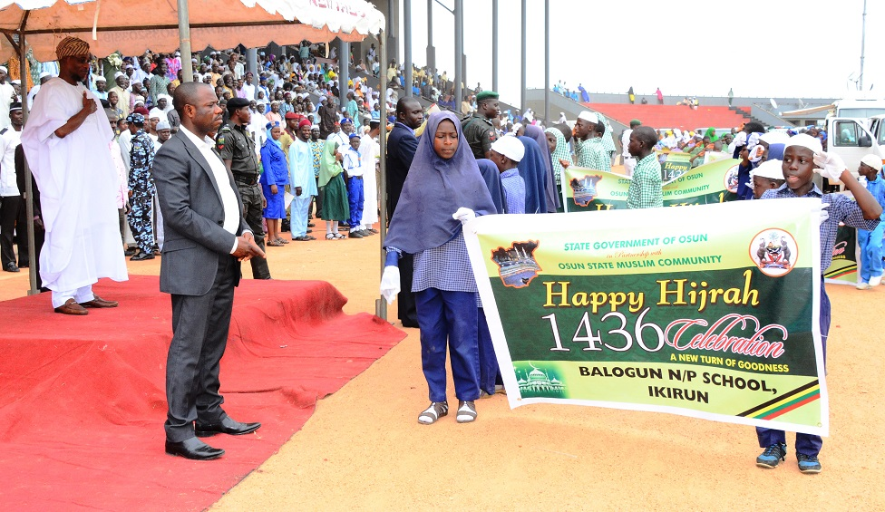 Governor State of Osun, Ogbeni Rauf Aregbesola acknowledging match-pass parade from some students of Balogun Nursery/Primary School during Hijrah 1436AH Celebration at Osogbo City Stadium on Saturday 25/102014