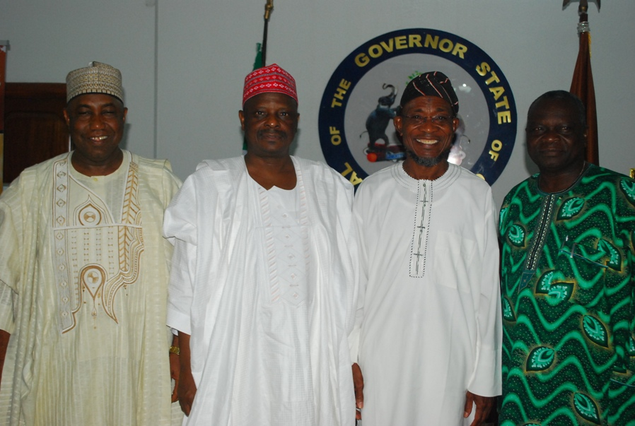 Governor State of Osun, Ogbeni Rauf Aregbesola (2rd right); his Kano State counterpart, Rabiu kwankwaso (2rd left); formal Osun Governor, Prince Olagunsoye  Oyinlola (right) and a Member of National Assembly representing Kano South, Sen.Kabiru Gaya, during Kwankwaso visit to Governor Aregbesola, at the Government  House Osogbo on Sunday 12-10-2014.