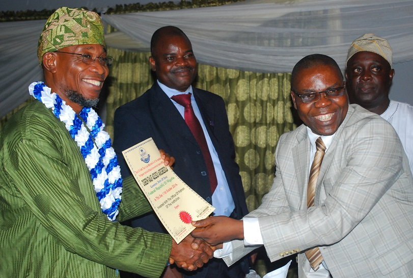 The Governor State of Osun, Ogbeni Rauf Aregbesola (left) ,1st Vice President of Nigerian Institute of Estate Surveyors & Valuers(NIESV), Mr Ajayi Patunola (right) and State Chairman of the Institute, Dr Seyi Adegoke, during the Investiture on Ogbeni as the Institute's Patron, at the Government House, Osogbo on Saturday 11-10-2014