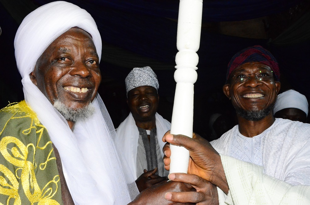 Governor State of Osun, Ogbeni Rauf Aregbesola presenting Staff of Office to newly turbaned Chief Imam of Osogboland, State of Osun, Sheikh Musa Animasaun, during an Installation ceremony,  at Osogbo Central Mosque, Osogbo on Sunday 19/10/2014.