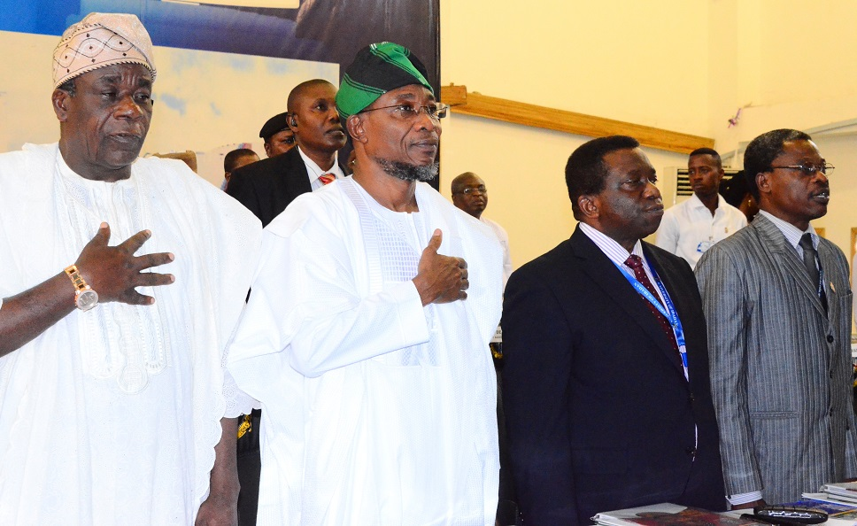 Guest Speaker/Governor State of Osun, Ogbeni Rauf Aregbesola (middle); Vice Chancellor University of Ibadan, Prof. Isaac Adewole (right) and Registrar Mr. Olujinmi Olukoyer (left) during the 2014 Convocation Lecture/66 Founder's Day Ceremony, at University of Ibadan on Tuesday  11/11/2014.