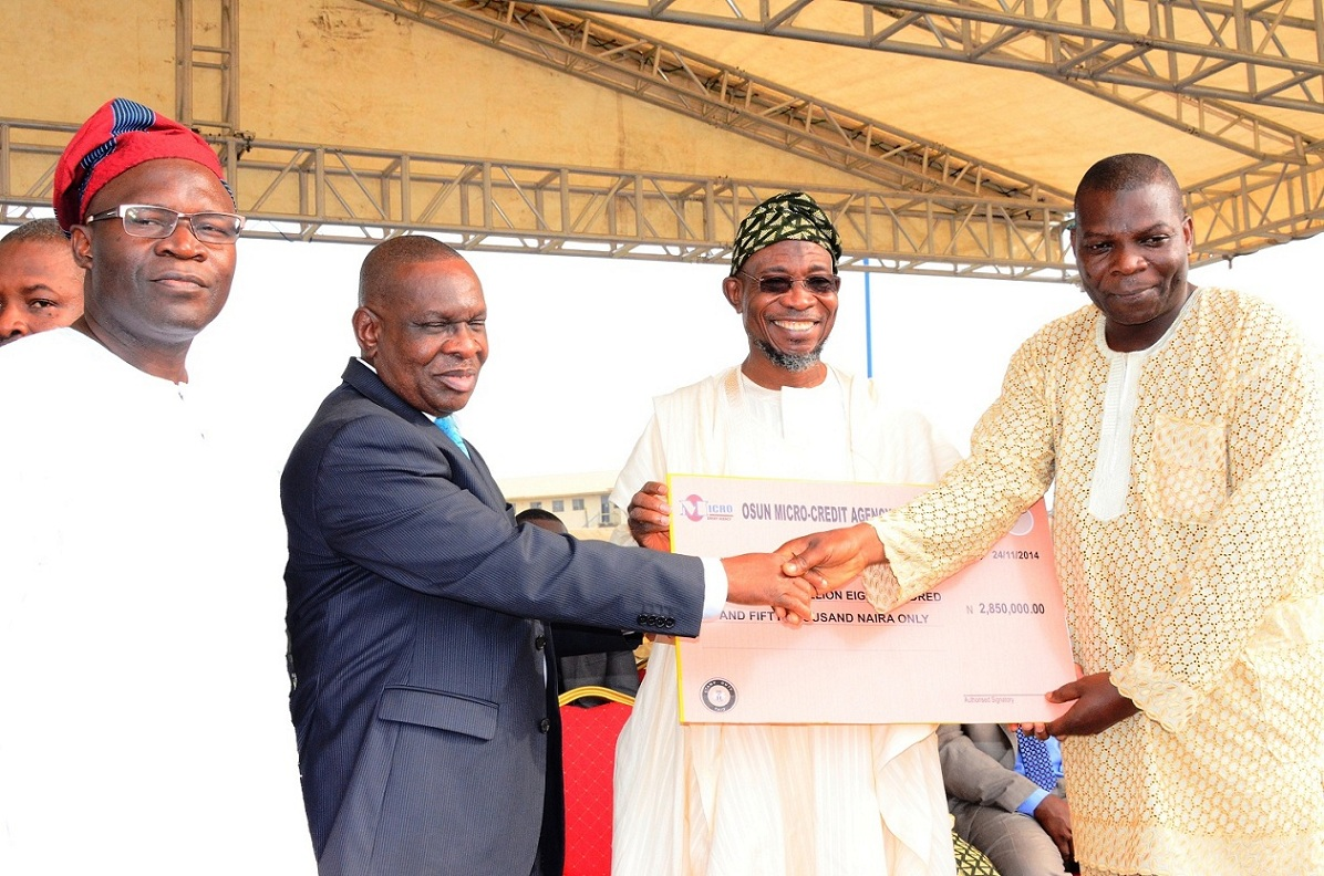 From left, Commissioner for Commerce, Industry, Cooperatives and Empowerment, Mr Ismaila Alagbada; Special Adviser to Governor, Central Bank Nigeria (CBN) on Development Finance, Mr Paul Nduka; Governor State of Osun, Ogbeni Rauf Aregbesola and Chairman, Motorcycle Transport Union of Nigeria (MTUN), Comrade Gbenga Ajenifuja, during the Disbursement of N2 Billion Accessed by the State to Loanees under the CBN N220 Billion Micro, Small and Medium Enterprises Development Fund at Nelson Mandela Freedom Park, Osogbo on Monday 24-11-2014
