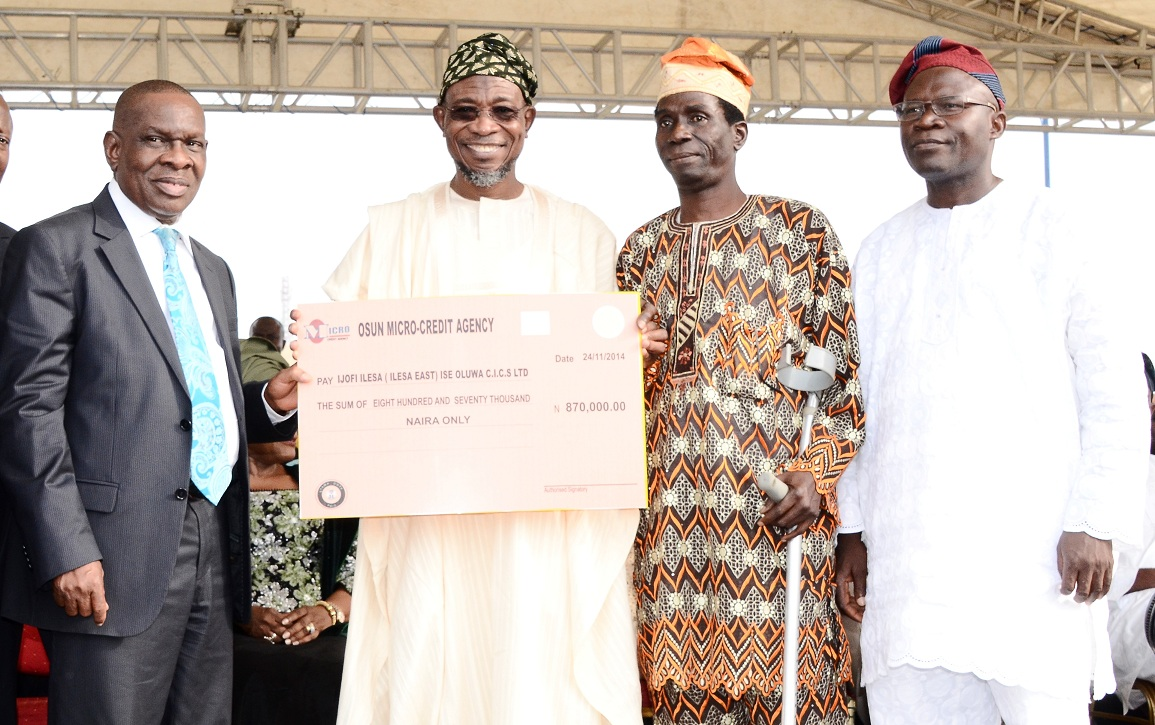 From left, Special Adviser to Governor, Central Bank Nigeria (CBN) on Development Finance, Mr Paul Nduka; Governor State of Osun, Ogbeni Rauf Aregbesola; Chairman, Ijofi Ilesa (Ilesa East) Ise Oluwa Cooperatives Limited, Mr Adedeji Adifagberu and Commissioner for Commerce, Industry, Cooperatives and Empowerment, Mr Ismaila Alagbada, during the Disbursement of N2 Billion Accessed by the State to Loanees under the CBN N220 Billion Micro, Small and Medium Enterprises Development Fund at Nelson Mandela Freedom Park, Osogbo on Monday 24-11-2014