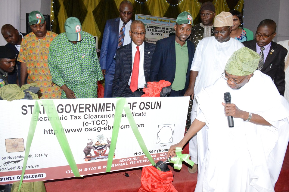 From right, Governor State of Osun, Ogbeni Rauf Aregbesola; Acting Chairman, Osun  Internal Revenue Service, Mr Dayo Oyebamiji and Director Medium, Tax Department of Federal Inland Revenue Service, Mr Peter Olayemi, during the launching of Electronic Tax Clearance Certificate (E-TCT), at Lesure Spring Hotel, Osogbo, State of Osun on Thursday 06-11-2014