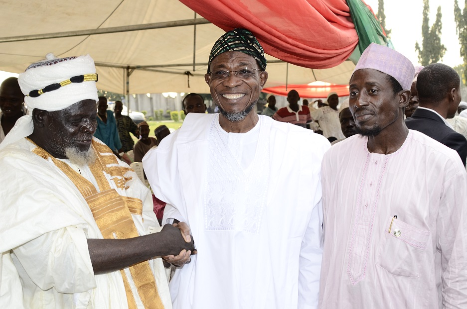 Governor State of Osun, Ogbeni Rauf Aregbesola (middle); Senior Special Assistant to the Governor on Arewa Matters, Imam Bashir Mohammed (right) and Leader, Osun Beggars and Disable's Association, Mallam Idris Kano (left), during a party organised by the Association in celebrating Aregbesola's re-election in Osogbo, State of Osun on Friday 07-11-2014