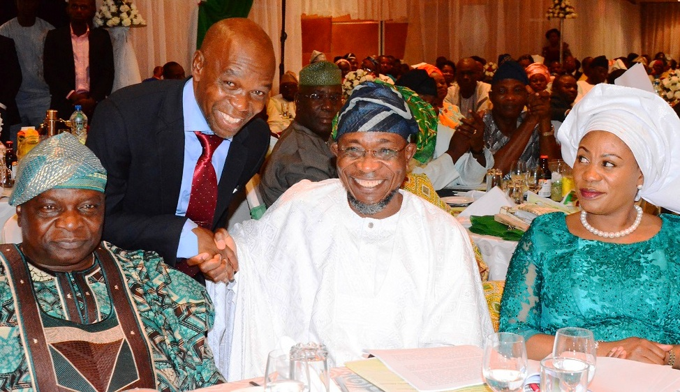 Governor State of Osun, Ogbeni Rauf Aregbesola; his wife; Sherifat (right); Former Governor State of Osun, Prince Olagunsoye Oyinlola(left) and Publisher/Editor-in-Chief The Gazelle news Online, Mr.  Musbau Rasaq (behind), during the Victory Colloquium for Aregbesola, at Eko Hotel Lagos State on Sunday 2/11/2014.