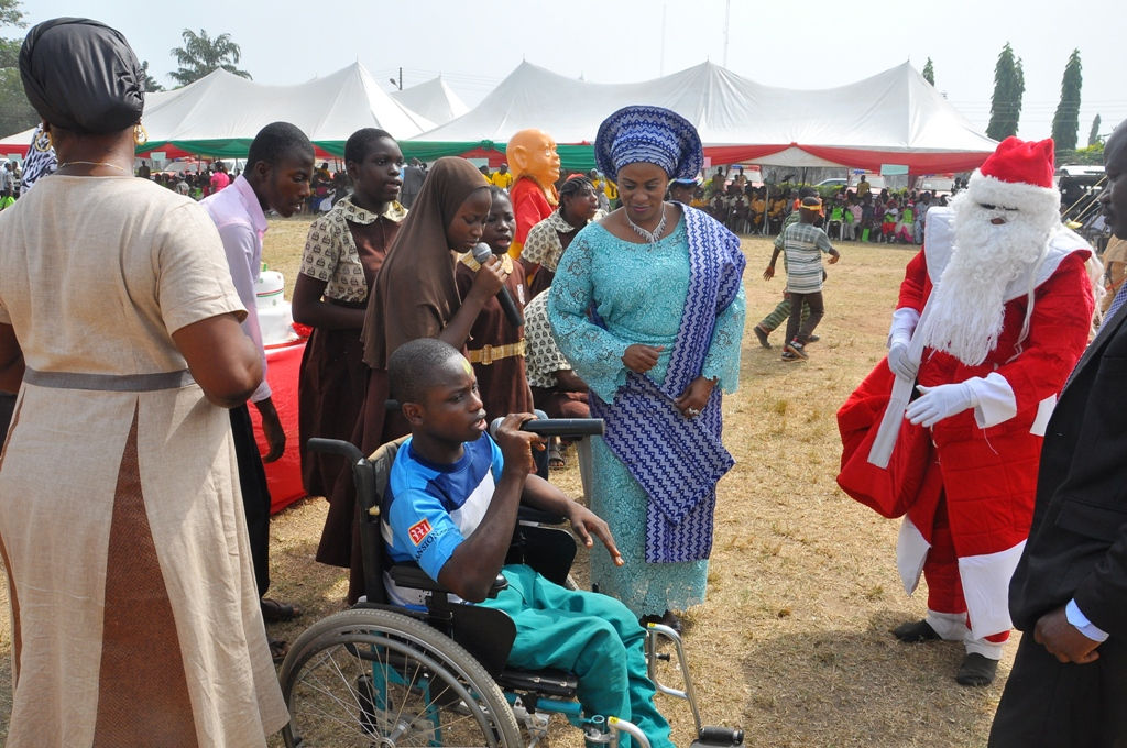 Wife of the State of Osun Governor, Alhaja  Sherifat Aregbesola dancing with less privileged Children, during the 2014 Children End of the Year Party, organised by office of the wife of the Governor in collaboration with Ministry of Women and Children Affairs, at Government House, Osogbo on  Wednesday 17-12-2014