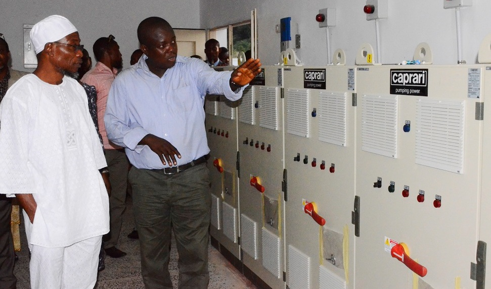 Governor State of Osun, Ogbeni Rauf Aregbesola (left) and Project Manager, Engineer Oladini Awoyemi (right) at the recent Inspection Tour to the Kajola Water Dam in the State of Osun