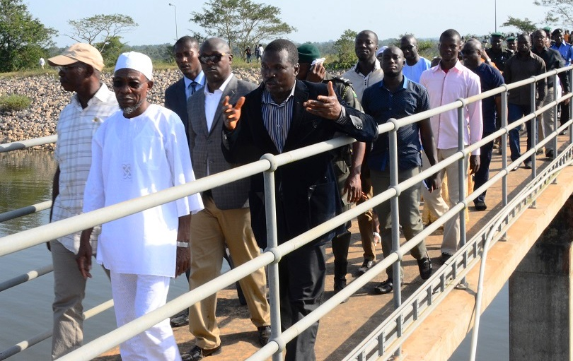 Governor State of Osun,Ogbeni Rauf Aregbesola (middle); Deputy General Manager, Osun State Water Corporation, Engnr.  Ogunsina Lawrence (right) and Former Deputy Chief of Staff to the Governor State of Osun, Mr. Gbenga Adebusuyi (left) at a Project Inspection Tour to the Owala Water Dam, Okinni, State of Osun on Tuesday 02/12/2014.