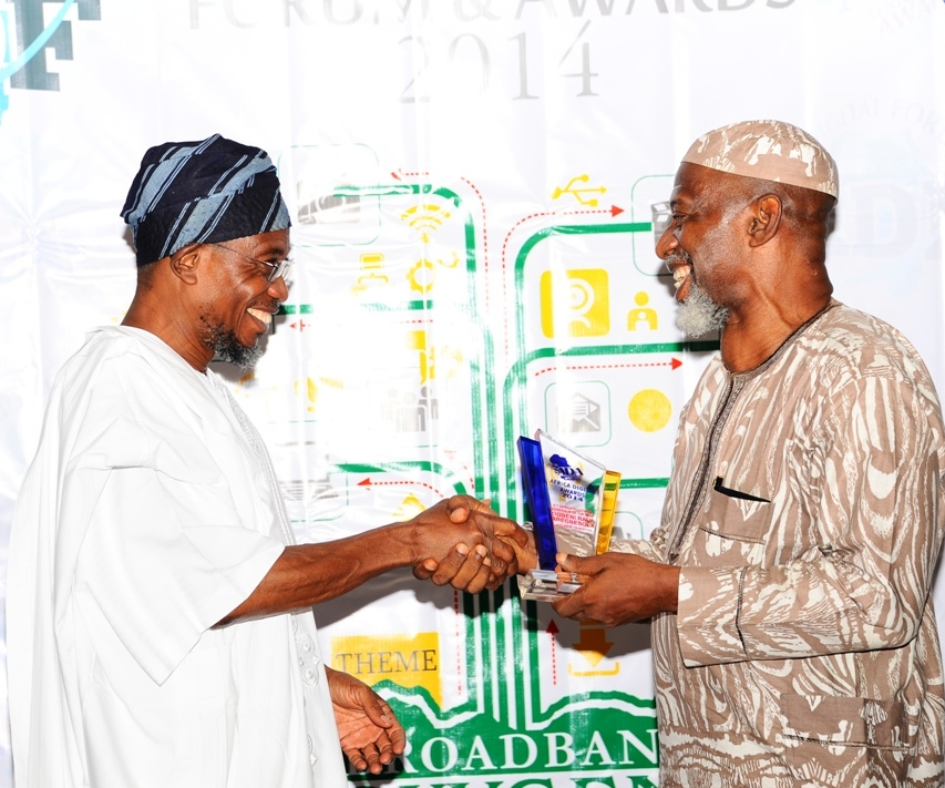 Governor State of Osun, Ogbeni Rauf Aregbesola, recieving an Award of ICT Infrastructural Governor of the year from  former Personal Secretary of Late Obafemi Awalowo, Chief Odia Ofeimun, during the Africa Digital Forum & Awards 2014 at Sheraton Hotel & Towers, lkeja Lagos on Sunday 14-12-2014.