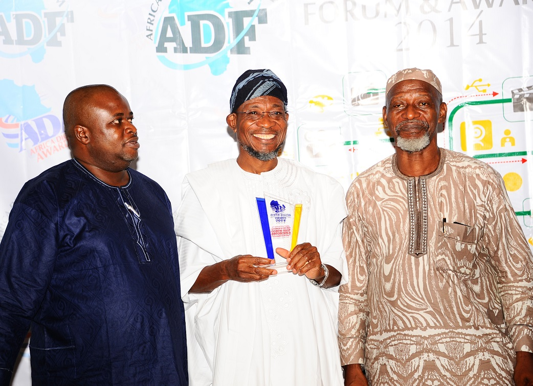 Governor State of Osun, Ogbeni Rauf Aregbesola (middle); Event Coordinator, Mr Tayo Adewusi (left); Former Personal Secretary to late Obafemi Awalowo, Odia Ofeimun (right), during Africa Digital Forum and Presentation of ICT Infrastructural Governor of the year Awards 2014 on Governor Aregbesola at Sheraton Hotel & Towers, Ikeja, Lagos. on Sunday 14-12-2014.