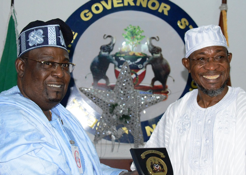 Resident Electoral Commissioner of Independent Electoral Commission ( INEC) in Osun, Dr.Rufus Akeju (left), receiving a State Plaque from Governor Rauf Aregbesola of the State of Osun, during a farewell visit at the Government House, Osogbo on Monday 29-12-214