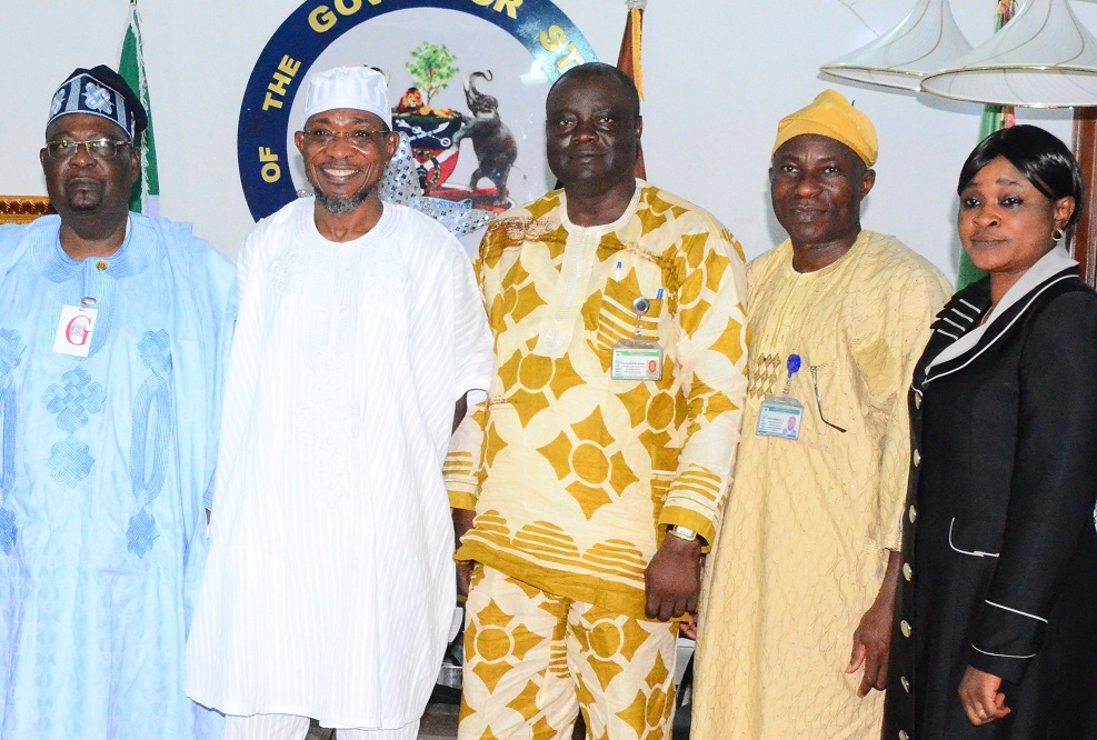 From left, Resident Electoral Commissioner of INEC in Osun, Dr.Rufus Akeju; Governor Rauf Aregbesola of the State of Osun; Osun INEC Administrative Secretary,  Mr. Oladipo Oladapo; Head of Department of Political Monitoring Team,  Mr. Niyi Opadiran and Public Affairs Officer, Mrs. Adenike Tadese, during a farewell visit at the Government House, Osogbo on Monday 29-12-214