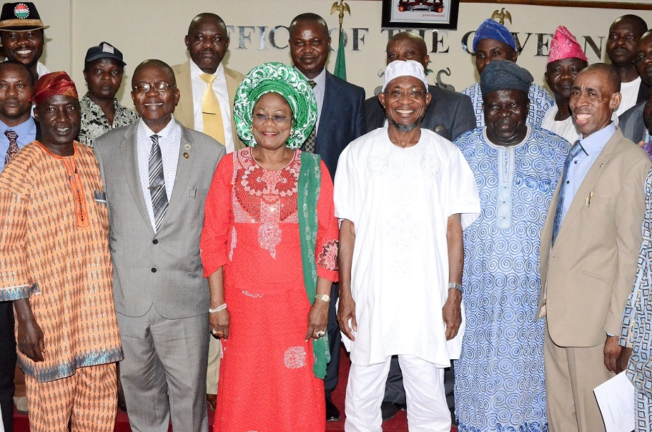 Governor State of Osun, Ogbeni Rauf Aregbesola (3rd right); his Deputy, Mrs Titi Laoye-Tomori (3rd left); Head of Service, Elder Olayinka Owoeye (2nd left); Chairman, Labour Committee on Internal Generated Revenue (IGR), Comrade Francis Adetunji (right); Chairman, Nigeria Labour Congress (NLC) Osun Chapter, Comrade Saka Adesiyan (left); Chairman, Joint Negotiating Council (JNC) Osun Chapter, Comrade Bayo Adejumo (2nd right) and others, during the Official Presentation of the Report Compiled by Labour on Ways to Improve the State IGR at Governors' Office, Osogbo, State of Osun