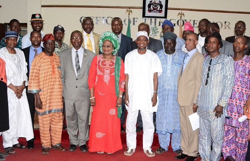 Governor State of Osun, Ogbeni Rauf Aregbesola (centre); his Deputy, Mrs Titi Laoye-Tomori (4th left); Head of Service, Elder Olayinka Owoeye (3rd left); Chairman, Labour Committee on Internal Generated Revenue (IGR), Comrade Francis Adetunji (3rd right); Chairman, Nigeria Labour Congress (NLC) Osun Chapter, Comrade Saka Adesiyan (2nd left); Chairman, Joint Negotiating Council (JNC) Osun Chapter, Comrade Bayo Adejumo (4th right) and others, during the Official Presentation of the Report Compiled by Labour on Ways to Improve the State IGR at Governors' Office, Osogbo, State of Osun