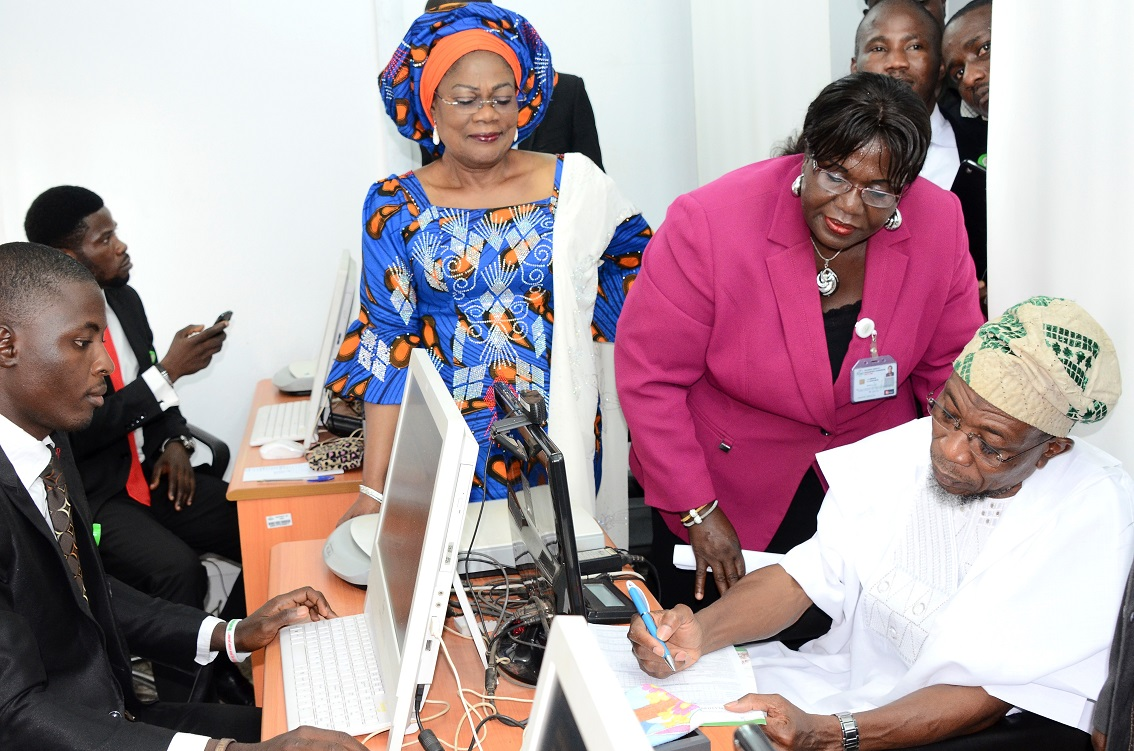 Governor State of Osun, Ogbeni Rauf Aregbesola (right) registering for his National Identity Card at the National Identification Number Registration Centre, Osogbo, State of Osun. With him are, his Deputy, Mrs Titi Laoye-Tomori (3rd right); Director Operations, National Identity Management Commission (NIMC) Abuja, Mrs Yahaya Cecilia (2nd right); Officer, NIMC Osun, Akinlabi Olusola (left) and others.