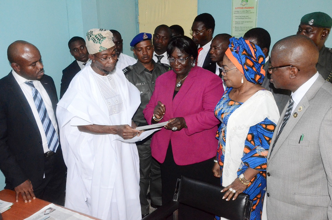 Governor State of Osun, Ogbeni Rauf Aregbesola (2nd left) collecting his National Identification Number from Director Operations, National Identity Management Commission (NIMC) Abuja, Mrs Yahaya Cecilia (centre). With them are, Deputy Governor, Mrs Titi Laoye-Tomori; Head of Service, Mr Sunday Owoeye (right) and othera, at NIMC Registration Centre, Osogbo, State of Osun